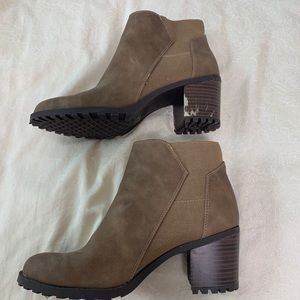 Taupe booties with imperfection on one heel